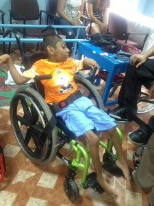 """This young boy has never had a wheelchair.  His family was in tears when receiving it from VYA.  Dad said, How can a broken man and a little boy come half way around the world to do more for my son then I have been able to do for him""""."""